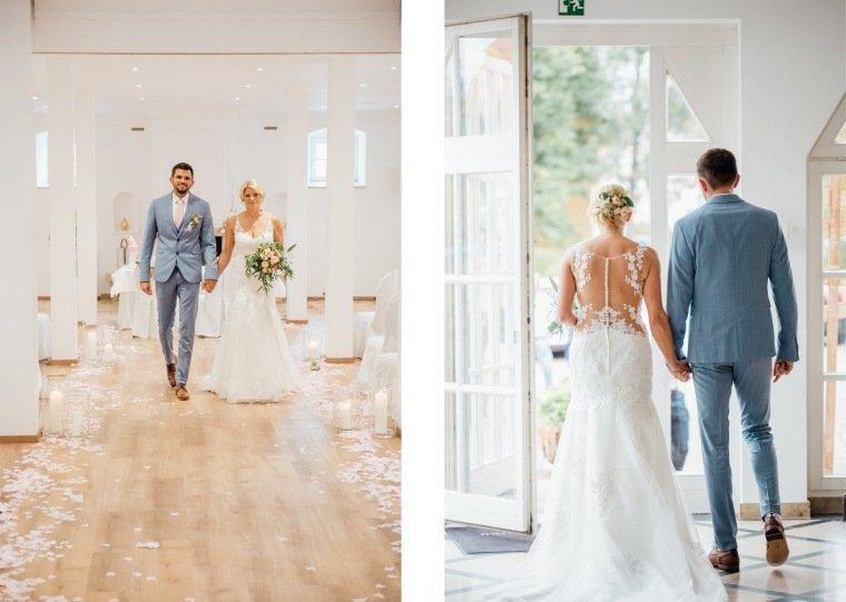 Hochzeitsfotos-Landgut-Schloss-Michelfeld-Hochzeitsreportage-Angelbachtal-043-Brautpaar-Tattoospitze-hellblauer-Anzug-freie-Trauung-Auszug