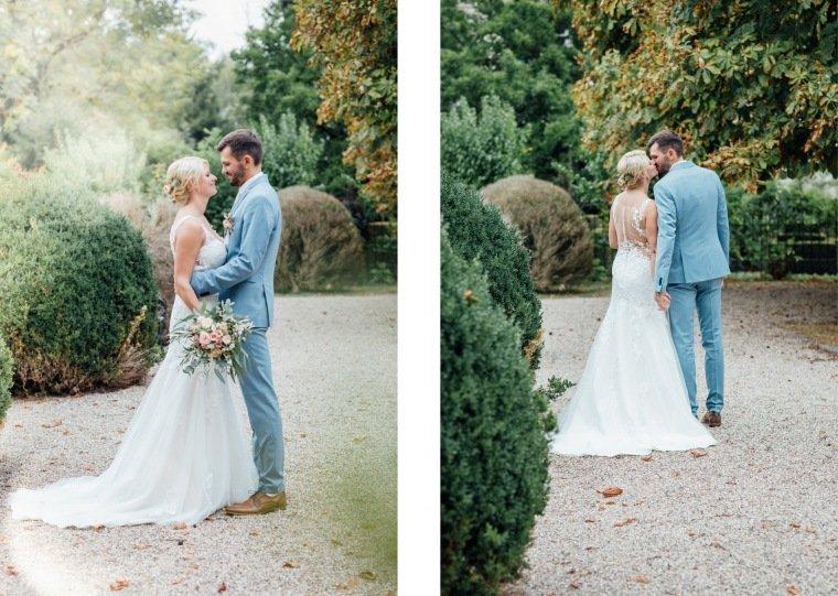 Hochzeitsfotos-Landgut-Schloss-Michelfeld-Hochzeitsreportage-Angelbachtal-045-Brautpaar-Tattoospitze-hellblauer-Hochzeitsanzug-Park